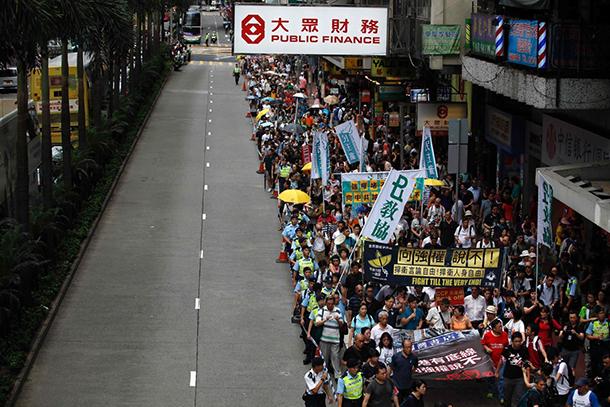 Hong Kong | Esperados 100 mil em marcha do aniversário da transição