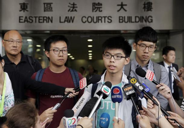 Hong Kong | Activistas Joshua Wong, Agnes Chow e Ivan Lam condenados a penas de prisão