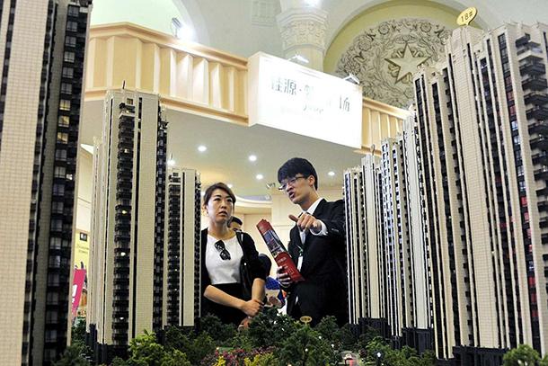 China tenta acabar com 'ponzi' imobiliário em transição para novo modelo económico